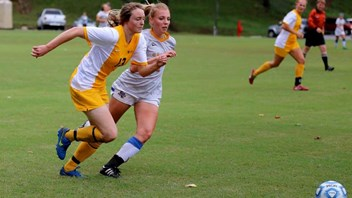 Caitlin Foster (in yellow)  on Football Scholarship in Kentucky