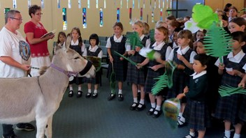 Students listen to the Gospel with Tilly the Donkey in Marsden Chapel