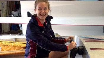 Assistant Rowing Coach Steph Taylor 'womans' the support boat
